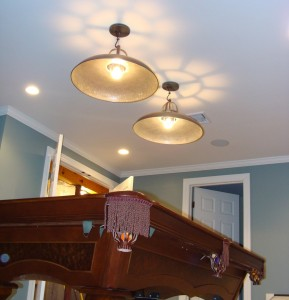 The Billiards Room ceiling shows one of two ceiling mounted speakers for music.